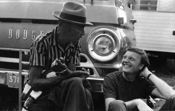 Texas bluesman Mance Lipscomb and Arhoolie Records founder Chris Strachwitz in 1960.