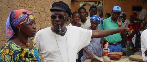 Ousmane Sembène on the set of Moolade , 2004.