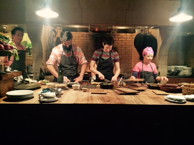 Camino's open kitchen, with Russ Moore (far left), cooking the Prune menu. Photo by Cari Borja