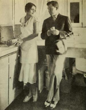 Stuart Erwin in the kitchen with wife June Collyer.