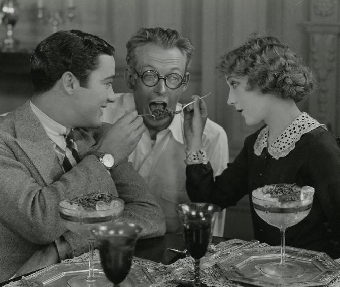 Buddy Rogers and Mary Pickford share a sweet treat with My Best Girl director Sam Taylor.