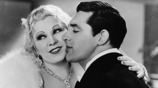 Mae West gets a kiss from Cary Grant in 1933's I'm No Angel .