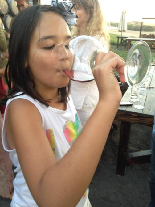 Royal drinking something red at Scribe. 2012.