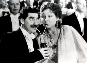 Groucho Marx and Margaret Dumont in A Night at the Opera (1931).