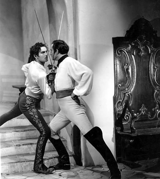 Tyrone Power and Basil Rathbone cross swords in 1940's The Mark of Zorro .