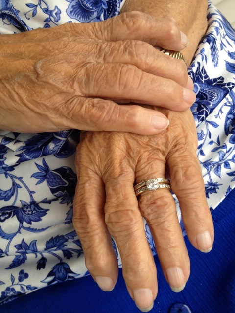 My grandmother's hands, and her blue muumuu. 2012.