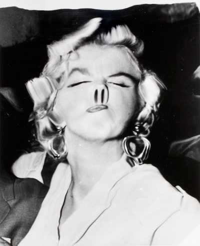 Hollywood glamour distorted: A 1950s photo of Marilyn Monroe by Weegee (Arthur Fellig).