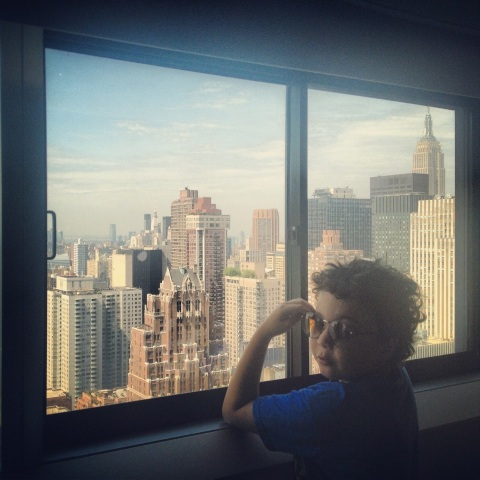 August (wearing vintage sunglasses) in NYC. Our room, One UN, 2013.