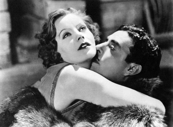 American actor John Gilbert kissing Swedish actress Greta Garbo (Greta Gustafsson) in the film Flesh and the Devil. 1926 (Photo by Mondadori Portfolio via Getty Images)