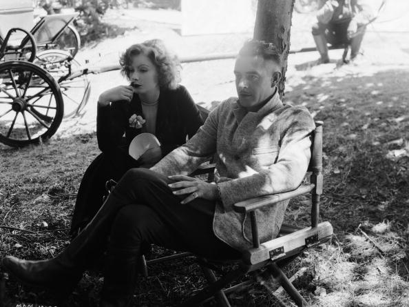 7th July 1927:  Swedish born American actress Greta Garbo (1905 - 1990) and her fellow actor and lover John Gilbert (1899 - 1936). The pair starred in several films together and their tempestuous off-screen relationship culminated in her jilting him at the altar.  (Photo via John Kobal Foundation/Getty Images)