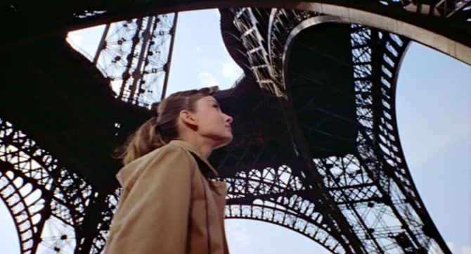 Jo (Audrey Hepburn) looking up at the Eiffel Tower in Funny Face .