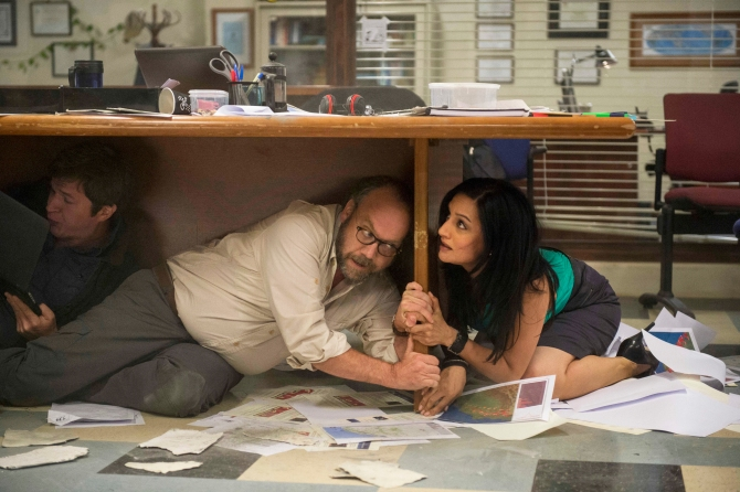 SAN ANDREAS - 2015 FILM STILL - Pictured: Paul Giamatti and Archie Panjabi as Serena - Photo Credit: Jasin Boland   © 2015 WARNER BROS. ENTERTAINMENT INC., WV FILMS IV LLC AND RATPAC-DUNE ENTERTAINMENT LLC - U.S., CANADA, BAHAMAS & BERMUDA  © 2015 VILLAGE ROADHSOW FILMS (BVI) LIMITED, WARNER BROS. ENTERTAINMENT INC. AND RATPAC-DUNE ENTERTAINMENT LLC - ALL OTHER TERRITORY