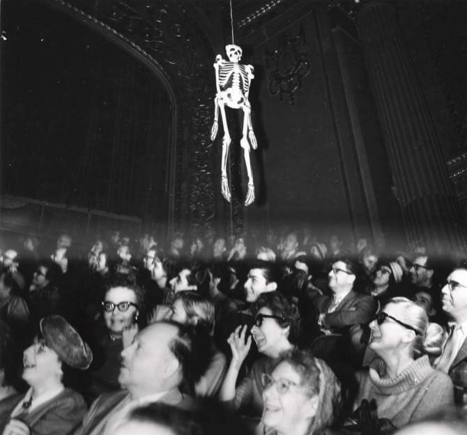 Skeleotn over audience weegee_.jpg