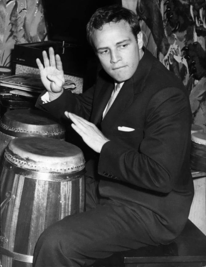 Brando playing the bongos.