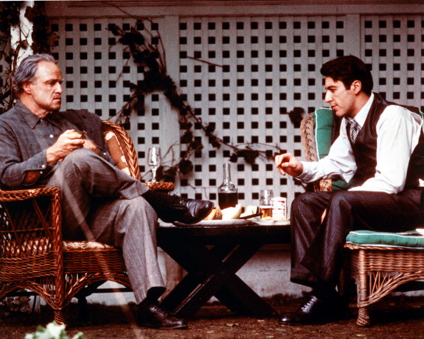 Marlon Brando as Don Vito Corleone and Al Pacino as Michael Corleone in a publicity still for The Godfather. Credit: Silver Screen Collection/Getty Images.