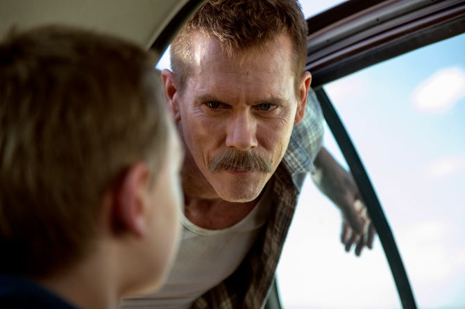 Sheriff Kretzer (Kevin Bacon) stares down Travis (James Freedson-Jackson in Cop Car. Courtesy of Focus Features.
