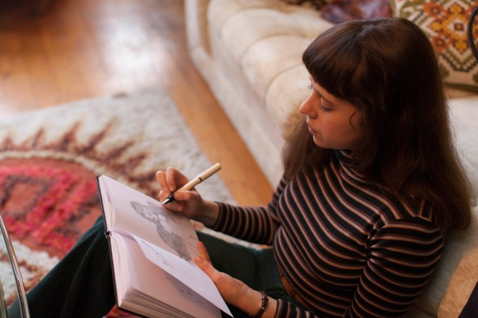 Minnie (Bel Powley) puts pen to paper in The Diary of a Teenage Girl.