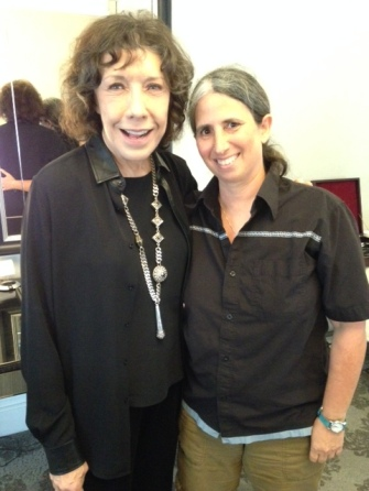Standing up: Lily Tomlin and Lisa Geduldig.