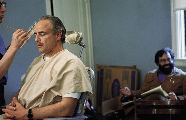 Marlon Brando and Francis Coppola (background) on the set of the The Godfather.