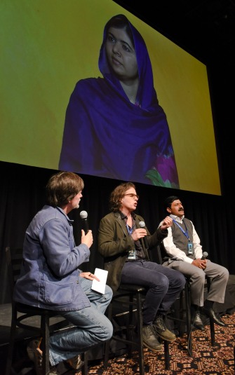 Directors Ken Burns and Davis Guggenheim, Ziauddin Yousafzai and his daughter Malala (via telecast) speak at a screening of He Named Me Malala; (Photo: Vivien Killilea, gettyimages)