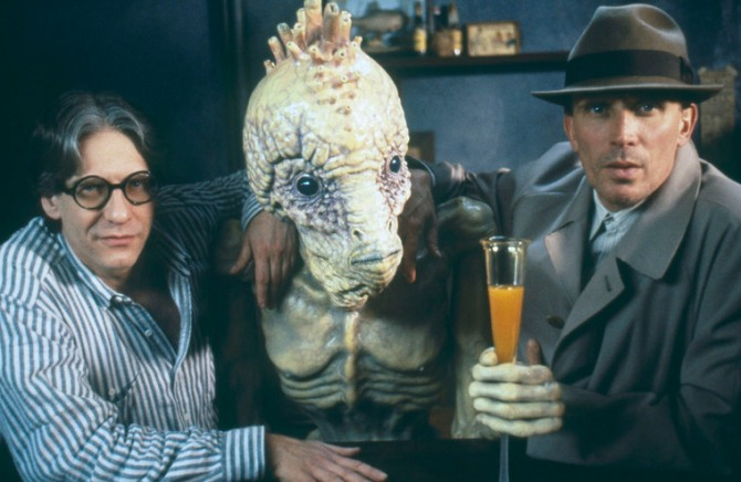 Director David Cronenberg and actor Peter Weller pose with a mugwump. Naked Lunch, 1991 – CREDIT: Photographer Atilla Dory© Recorded Picture Company (Productions) Limited and Naked Lunch Productions Limited, 1991