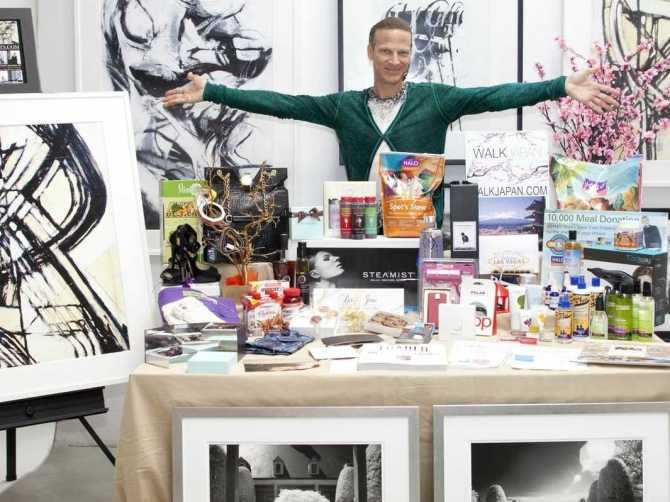 Lash Fary with some of the 2014 Unofficial Oscar Goodie Bag goodies his team assembled. –Photo courtesy of Business Week
