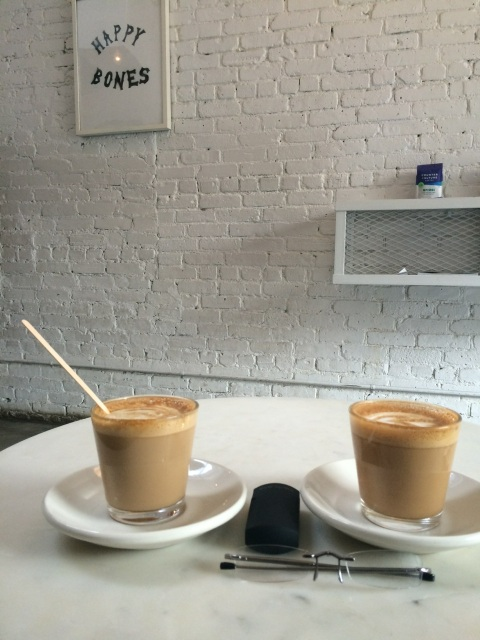 Our flat whites (aka lattes) with Eye Spies, at Happy Bones.