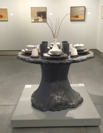 A ceramic table by NBC Pottery and paintings by Gideon Rubin and Dan Jackson are included in NOURISH at Napa Valley Museum