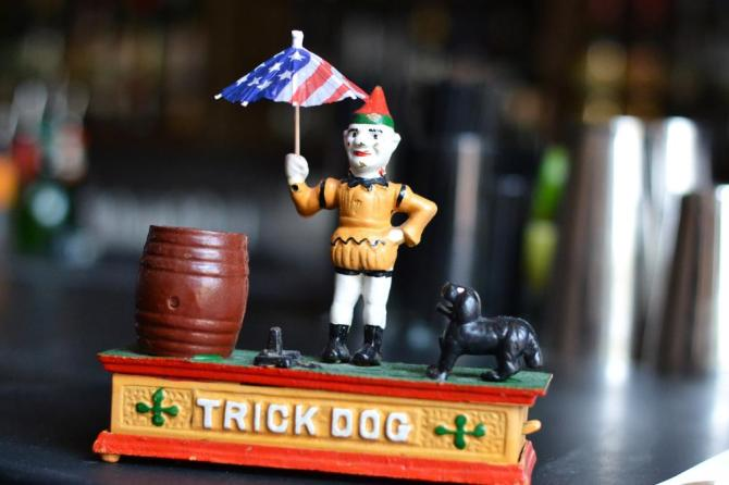 Trick-Dog-founder-Josh-Harris-named-the-bar-after-one-of-these-vintage-cast-iron-piggy-banks-the-clown-usually-holds-a-hoop-for-the-mechanical-jumping-dog._.jpg