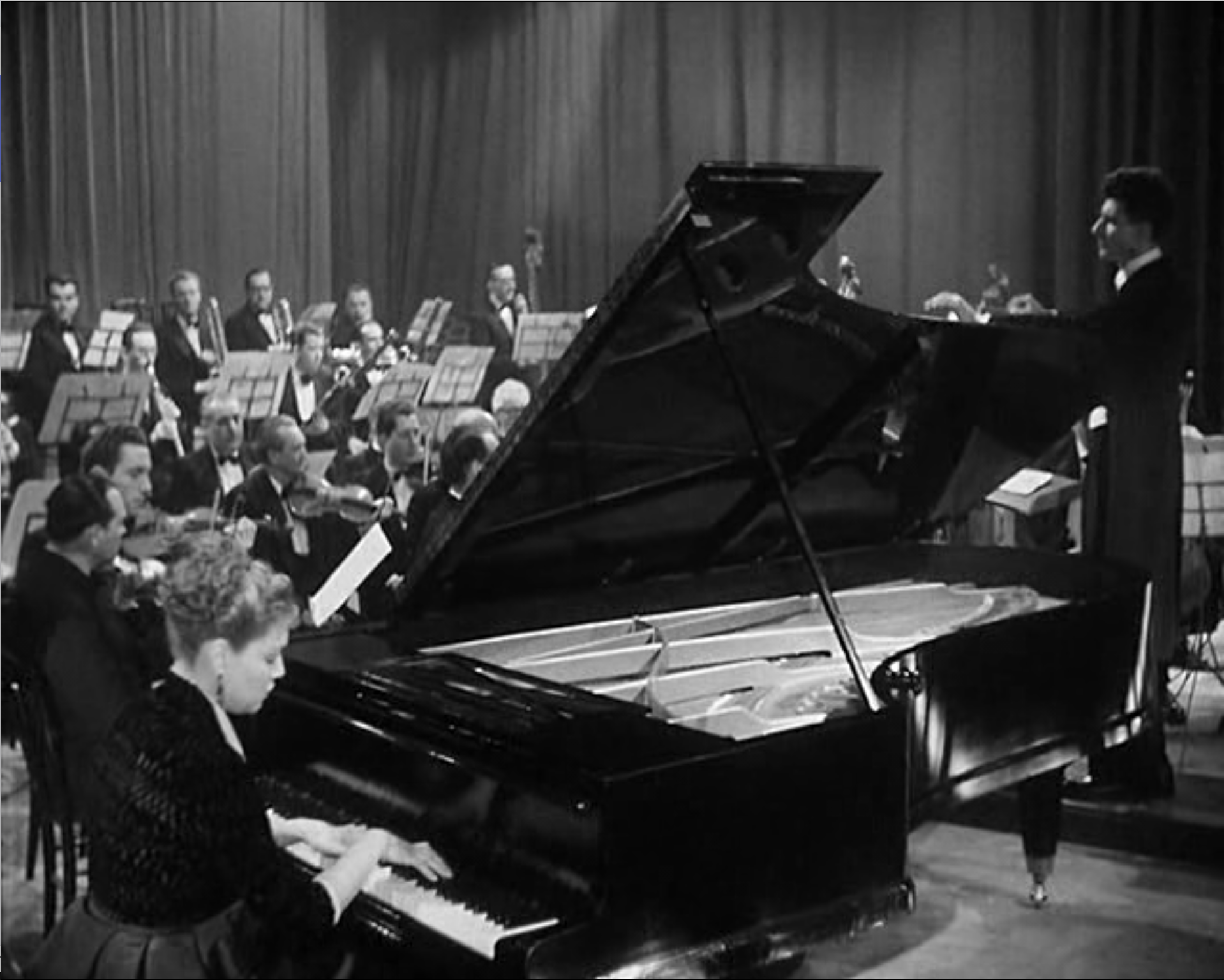 Signoret at piano.png