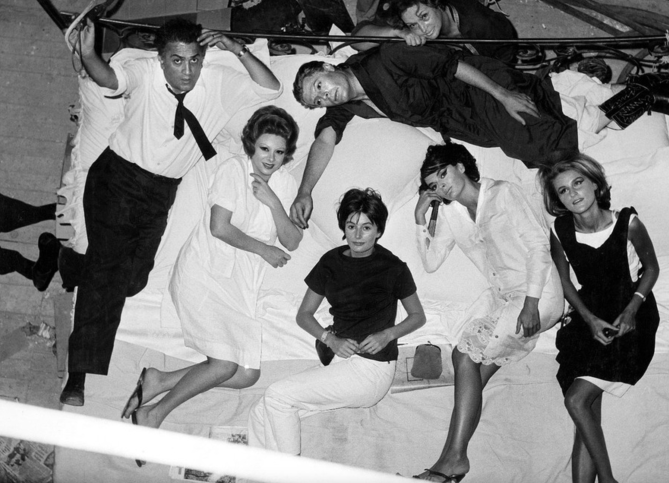 Fellini and cast on the floor.png